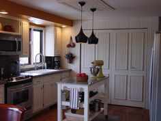 i am proud of my kitchen, home decor, kitchen design, Kitchen redone sink area baking table and doors beyond hide the washer aand dryer