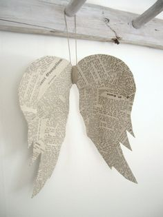 diy paper wings - photo only - cut wing shapes from card stock or thin cardboard; attach torn book pages with mod podge; wrape yarn or twine around center and  make hanger to match!