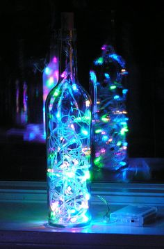 DIY bottle lights. Need a wine/liquor bottle or clear vase. A small strand of holiday lights of your choice. Battery or electrical works. A hammer and screwdriver. Chisel or drill a hole at the bottom of bottle big enough to thread lights through. Decorate bottle however you like. Super simple with a super visual impact. Enjoy!