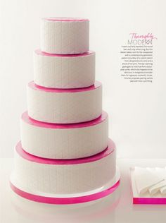 I kinda love this wedding cake.Its so simple and modern. I love the texture detail in the fondant. Very cool.