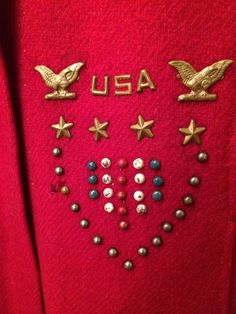 Patriotic detail on a child's red, wool cape.