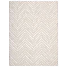 love how neutral this rug is + chevron pattern