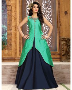 1. Green taffeta silk embroidery anarkali suit 2. Embroidered work in front with front slit jacket 3. Comes with a matching cotton inner and navy blue colored suit with lehenga 4. Can be stitched up to size 46 inches