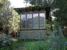 Jeff Shelton garden hut -- constructed with reclaimed wood and vintage doors and windows.