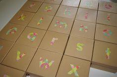 Alphabet boxes. Montessori method for teaching sounds.
