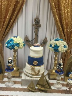 Gold and blue cake at a nautical baby shower party! See more party planning ideas at CatchMyParty.com!