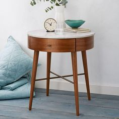 Well-rounded. Inspired by mid-century design, our Penelope Bedside Table stands on slim, tapered legs. Its marble top is wide enough for stacks of bedtime reading, while the rounded drawer is perfect for storing knick-knacks.