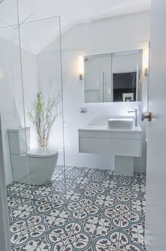 tile flooring for bathrooms this beautiful white bathroom design has combined a modern white vanity unit and toilet with a more traditionally inspired pattern tiled floor marble tile bathroom floor id Bathroom Tile Designs, Bathroom Floor Tiles, Bathroom Renos, Bathroom Design Small, Bathroom Interior Design, Basement Bathroom, Bathroom Cabinets, Bathroom Gray, Toilet Tiles Design