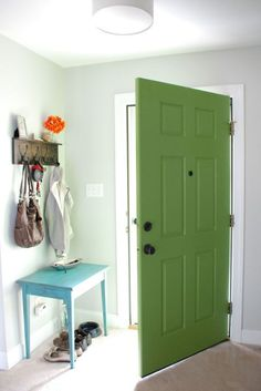 Yes, it's a great way to spruce up your home's curb appeal, but think about how much wall space it occupies on the inside of your home. Adding a coat of paint in a shade that complements your decor is the perfect way to take advantage of that real estate, much like this blue door from the aptly-named Lively Green Door.