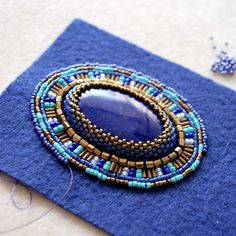 The creation of a lapis lazuli pendant in Mediterranean colors. - # The creation of a lapis lazuli pendant in Mediterranean colors. Bead Embroidery Tutorial, Bead Embroidery Patterns, Seed Bead Patterns, Jewelry Patterns, Bracelet Patterns, Beading Patterns, Embroidery Designs, Embroidery Stitches, Embroidery Floss Bracelets