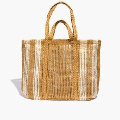 "A light, airy beach tote big enough for all your seaside stuff. Made of heavy-duty abaca straw (it comes from the stalks of bananas!), this design-team favorite has braided double top handles and over-the-shoulder straps.  <ul><li>Straw.</li><li>10 1/5"" handle drop.</li><li>14""H x 17""W x 21 3/10""D.</li><li>Import.</li></ul>"