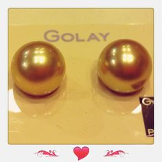 A pair of golden south sea pearls perfect round, 13mm.  Good luster.  Priced at $5200.