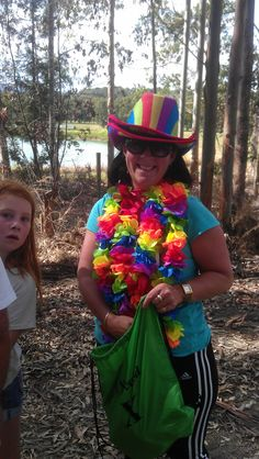 FRUITLOOPER FINERY - Even though she stole my Hawaiian lei idea, I still liked this Fruitlooper's bright and colorful costume. Believe me - the hat was a commitment to the cause because it was HOT! More fun things to do in Matakana here..  http://www.matakanacountry.co.nz/markets-lodging-accommodations-auckland-coast-wine-country-hotels/the-best-of-matakana-things-to-do-in-matakana-nz-auckland-wine-region-area-attractions/ #matakana #newzealand #thingstodo #summer #holidays #travel