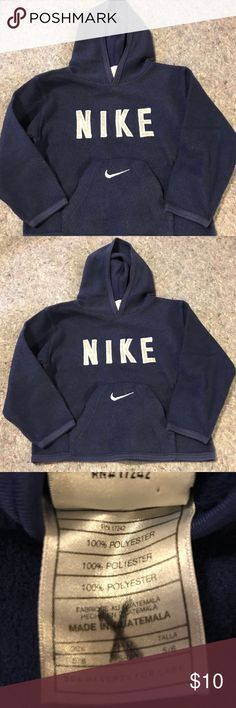 """NEW LISTING Navy """"Nike"""" SZ 5/6 Sweatshirt Used condition Nike Sweatshirt with lots of life left in it.  Navy blue with white """"Nike"""" wording. Boy's Size 5/6. From a smoke free home. Nike Shirts & Tops Sweatshirts & Hoodies"""
