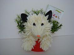 Possum, too cute. Floral animal arrangement made from silk flowers.  Website:  http://epetalsbyelizabeth.com/
