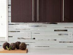 Interior. Modern kitchen decoration using dark brown wooden laminate kitchen cabinet including white granite kitchen counter tops and…