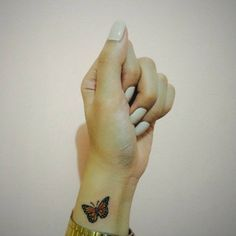 Little wrist tattoo of a butterfly on Kimberly.