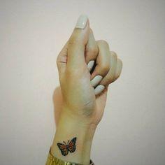 Little wrist tattoo of a butterfly on Kimberly.