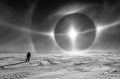 The image above may look like the illustration for a vintage science fiction movie, an astronaut transfixed by an alien sun on a desolate planet. But no, it's just another day on Earth. Frankly, it sometimes feels like we don't deserve this world and its myriad wonders.