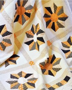Quilt Featuring Orange and Black Blocks on Craftsy blog.  Halloween quilts galore!