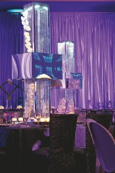 Lampshade enclosing a mesh column accompanied by a string of phalaenopsis orchids. Location: Turnberry Isle Miami Miami, FL; Event Design and Planner: Forever Events Bal Harbour, FL; Floral Design: Pistils & Petals Miami, FL; Rentals: Nüage Designs Miami, FL; Lighting: PSID Group; Draping: GMB Lighting; Photography: Matt Horton, Artist Group Miami, FL
