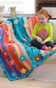 If you're looking for a free crochet pattern that will warm your heart, this Christmas Heirloom Afghan is it. Red Heart Holiday yarn is used to work up this festive crocheted afghan that is comprised of 30 squares sewn together.