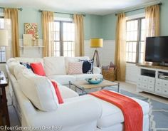 bad photo quality & ignore curtains BUT the wall detailing with aqua is cute. love the accents of coral & navy.