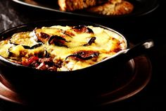 A kosher take on the classic Greek recipe for moussaka is made with eggplant, ground beef, tomatoes, and a dairy-free béchamel topping. Lamb Moussaka Recipe, Mousaka Recipe, Greek Dishes, Main Dishes, Hamburger Meat Recipes, Meat Meals, Tomato Bread, Lamb Curry, Greek Recipes