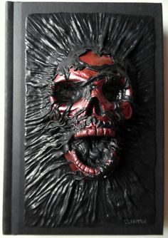 Its a unique notebook with handmade polymer clay cover - grave metallic red skull. Notebook has 100 white sheets. You could use it as journal or
