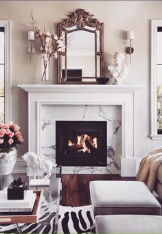 Dreamy marble fire place. This would be a great place to cozy up with a book.