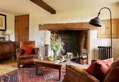 cotswold house renovation cosy living room fireplace