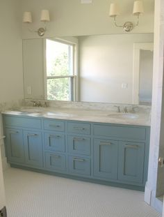 "Glam bathroom with blue double bathroom vanity painted Van Courtland Blue with marble countertops, Visual Comfort Lighting Vendome Double Sconces and 1"" hex tiles floor."