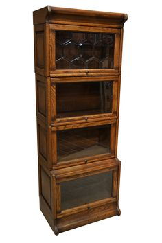 4 Stack Barrister Bookcase with Leaded glass on the top panel. Our Arts & Crafts / Mission Mahogany Barrister Bookcase is four stacks high with leaded glass on the top stack. This is a high quality bo