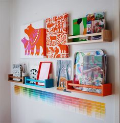 Tea towels + painted IKEA spice racks + paint chips = great, cheap wall vignette for child's room.