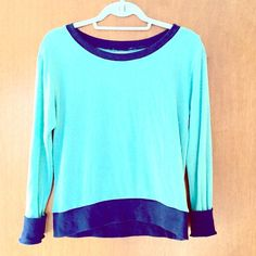 Soft Colorblocked Sweater Long-sleeved shirt is soft and lightweight, halfway between sweater and shirt.  Dark blue band around hemline of sweater and sleeves. Sweaters Crew & Scoop Necks