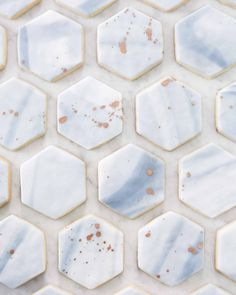 Guests left this wedding with a sweet treat: sugar cookies iced with marbled fondant resembling Italian tiles from Rose Cakes.
