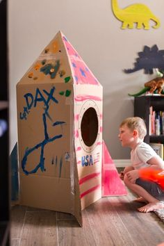 How to Make a Spaceship from a Cardboard Box Cardboard Crafts Kids, Big Cardboard Boxes, Cardboard Toys, Cardboard Box Ideas For Kids, Cardboard Playhouse, Cardboard Castle, Cardboard Furniture, Cardboard Spaceship, Cardboard Rocket