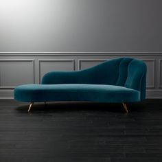 Shop Copine Peacock Velvet Curved Chaise Lounge. Designer Julia Von Werz reimagines the 19th century fainting sofa for modern times. Rich peacock blue velvet hugs every last exaggerated curve for a chaise lounge look that's fiercely feminine.