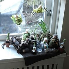 Spring leaf boys suspended over nature table - do them in autumn colours like leaves falling from treetops