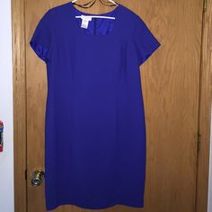 Formal dress Blue in color about knee length and zips in the back. Excellent condition! Size 16W Worthington Dresses