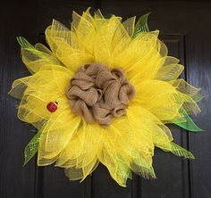Door wreaths made from a sunny flower will happily greet your guests. Learn from the easy tutorial and video