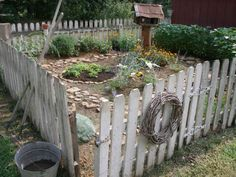 I want a cute fenced garden like this!!