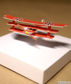 Made a time lapse video of the complete process of making a miniature paper airplane model.   This is the famous Fokker Dr.I flown by the Red Baron.