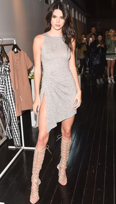 KENDALL JENNER in a gray knit dress with sexy thigh-high slit and knee-high lace-up boots (both of her own design!) for the launch of Kendall + Kylie in N.Y.C.