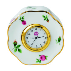 Youthful and exuberant, this Clock makes a beautiful addition to a bright and feminine vanity or desk, and is rendered in fine bone china with intricate detailing, vibrant colors and a lustrous gold rim.