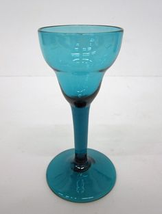 Wineglass  England   1770's Peacock green, presumably lead glass, slightly bubbly. Double-ogee bowl drawn stem, applied sloping circular foot with rough pontil mark.