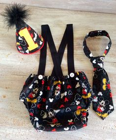 Boy Mickey Mouse Cake Smash Birthday Outfit with Suspenders Tie and Party Hat Baby Boys First Birthday by CuteAsClaire on Etsy https://www.etsy.com/listing/212480754/boy-mickey-mouse-cake-smash-birthday