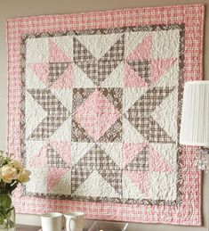 Big block baby quilt in pink and brown flannels that are easy to make with triangle-squares.