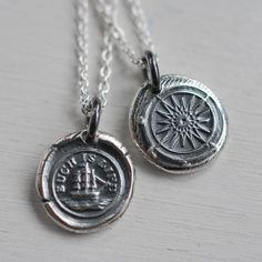 Love this little charm.  Reversible victorian seal pendant.