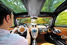Pagani Huayra in the Italian hills interior dashboard driving shot